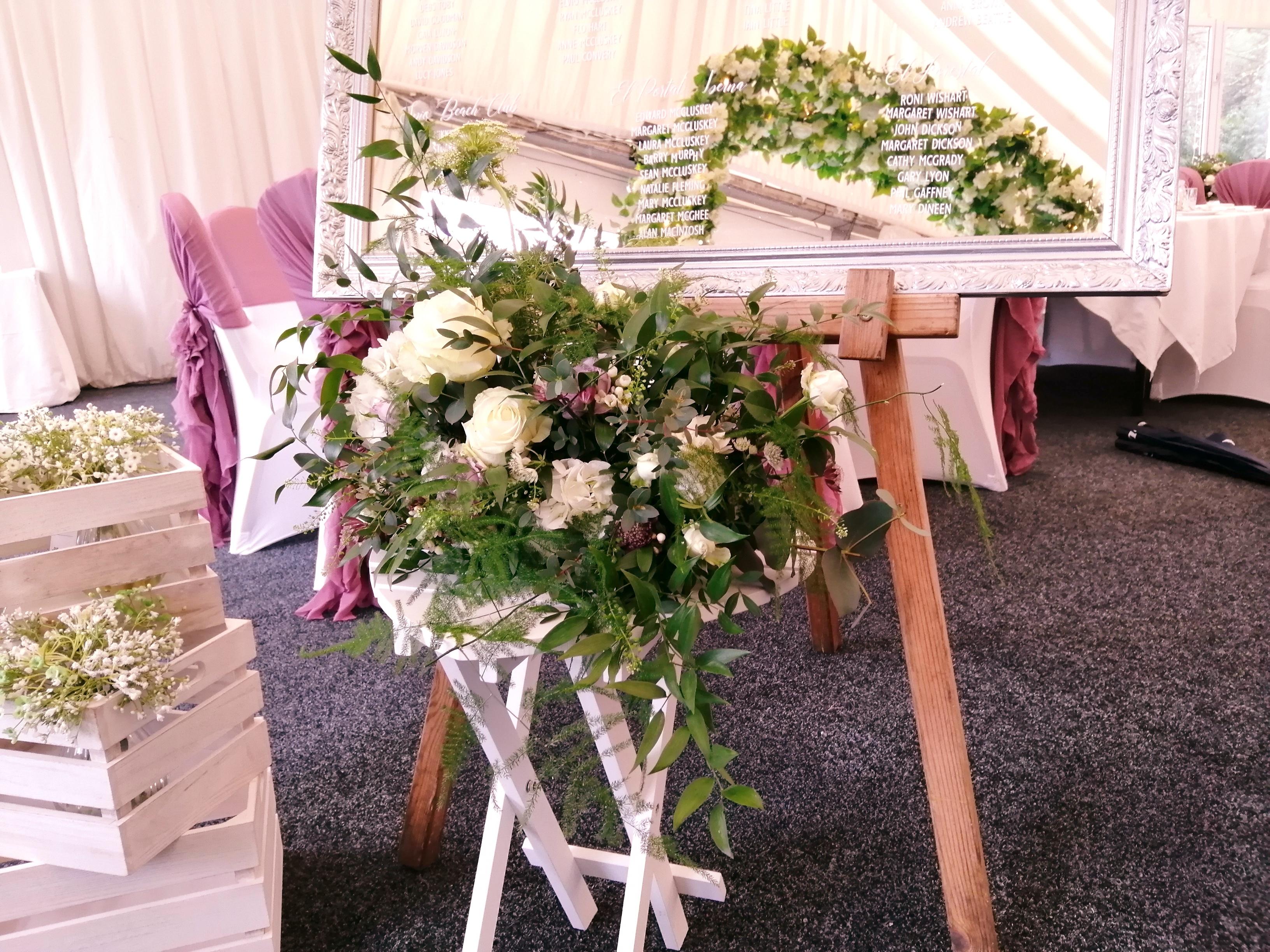 Heart Table displaying a floral arrangem