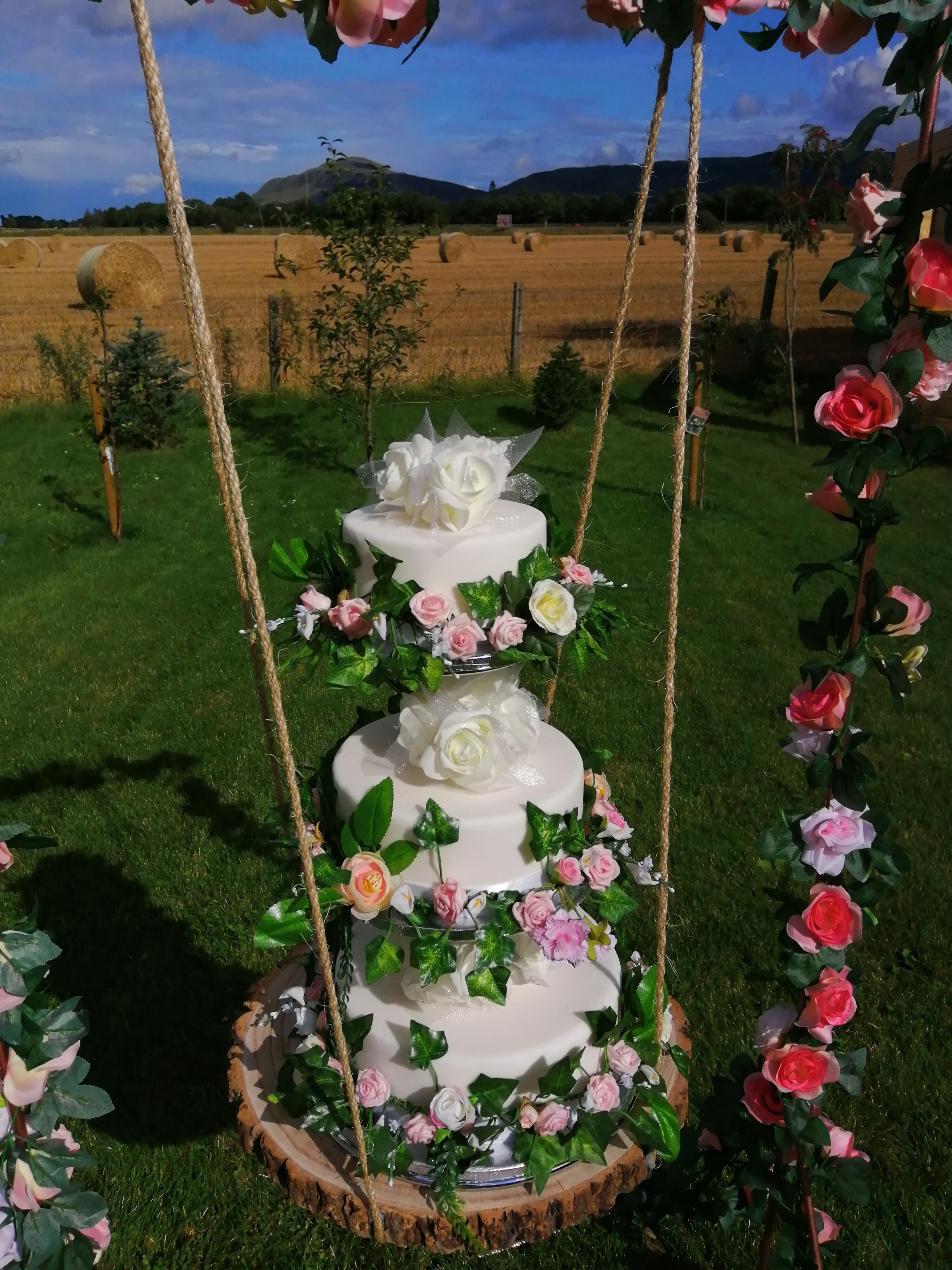 Wedding Cake Swing with faux cakes