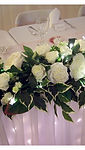 Stunning top table/signing table wedding flower arrangement with tiny LED lights