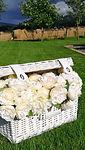 White wicker basket with peony flower po