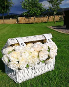 White wicker basket with peony flower po