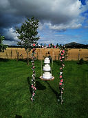 Wedding Cake Swing with white faux weddi