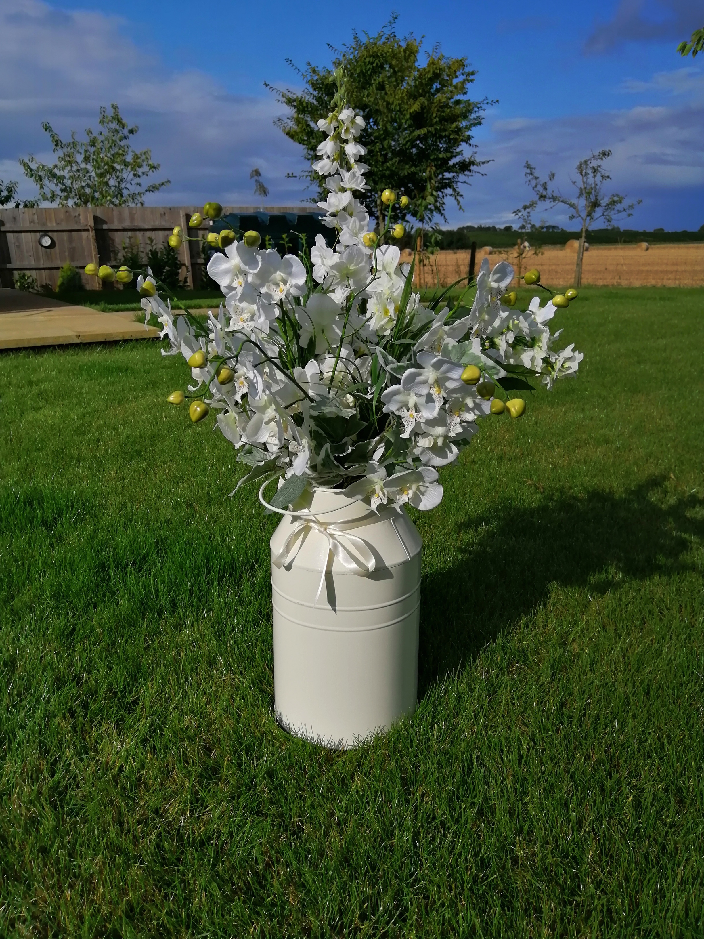 Milk Churn with flowers and foliage