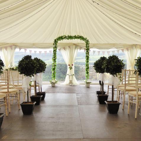 Bay Trees creating a wedding aisle