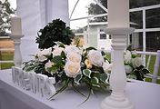 Registry Signing Table with floral arrangement, Mr & Mrs Sign, and Candlesticks from Limelight Weddings