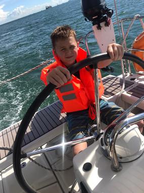 Child steering boat