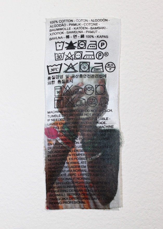Faceless farmer on clothing tag