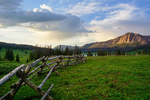 Corral fence and landscape at Brooks Lake Lodge, an all inclusive resort in Dubois, WY
