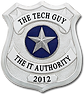 The Tech Guy logo, a silver badge with a silver star with a blue circle backgound in the middle with The Tech Guy at the top and The I.T. Authority at the bottom with 2012 under.