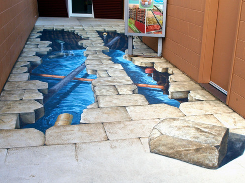 An anamorphic hole in the floor at Amaze n Things, Austalia.