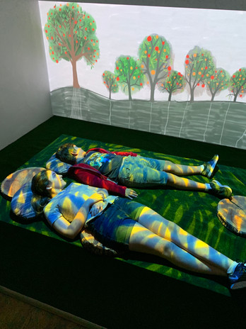 Projection playing over children