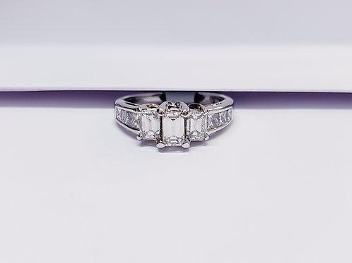 Three Emerald Cut Diamond Ring W/ Princess Cut Side Stones