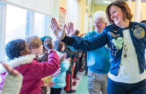 Paul high-fiving children at Farwell Elementary School in Lewiston, Maine.