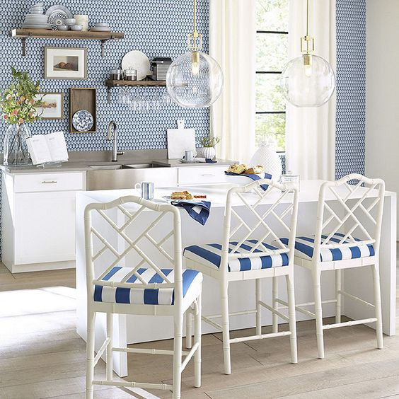 Blue kitchen with white bamboo bar stools