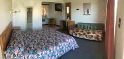 Room with queen bed and couch