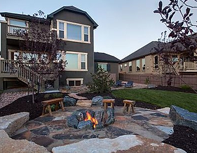 Outdoor stone patio wih bonfire pit