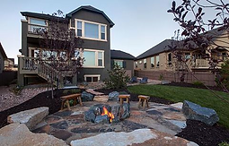 Outdoor stone patio with bonfire pit