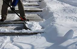 person shoveling driveway