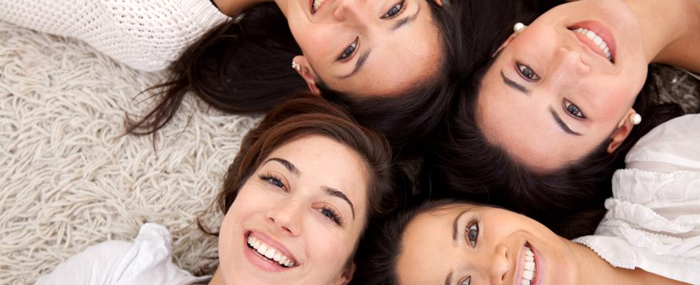 Ladies laying on carpet smiling