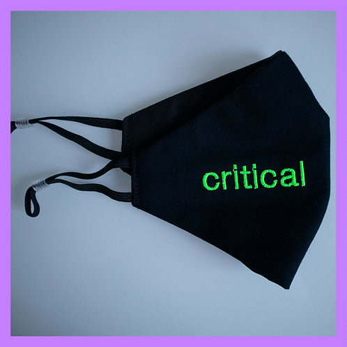 face mask with 'critical' embroidered in neon green