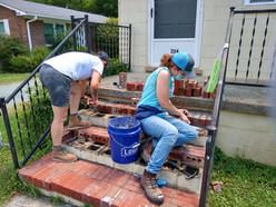 Kate and Kat repair brick steps.jpg