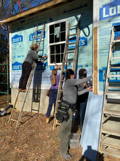 Trainees replace siding on job site