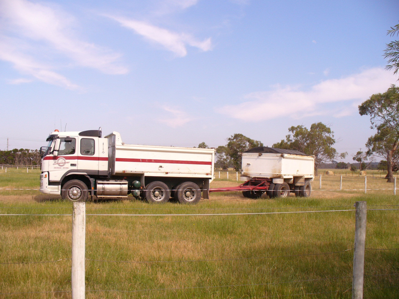 First truck load of dirt arrives to raise the site level 300mm..