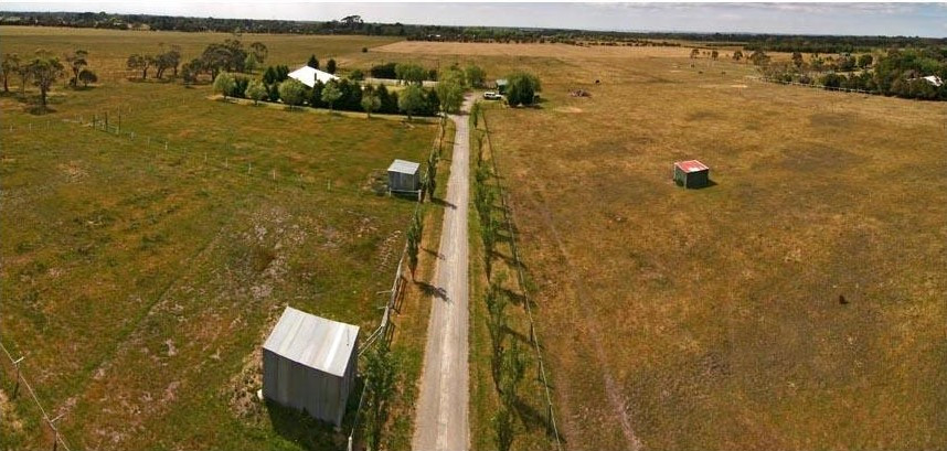 Aerial view of drive looking from road, and nursery site on the left of drive.