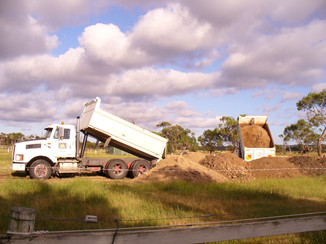 The dirt is coming in fast now, 2 trucks at a time.