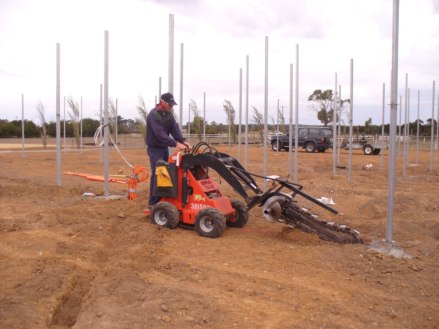 Jason digging trenches for water pipes and electrical underground.