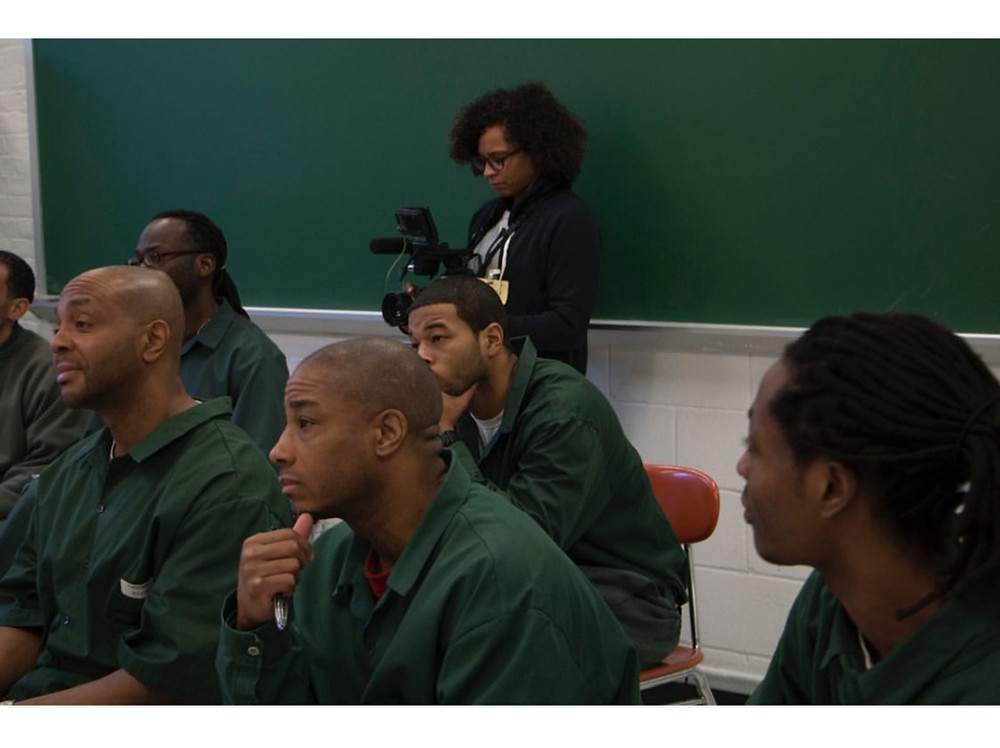 Patrick and his classmates during a recording of the College Behind Bars documentary.