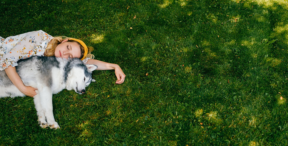 young-romantic-woman-lying-with-dog-gras