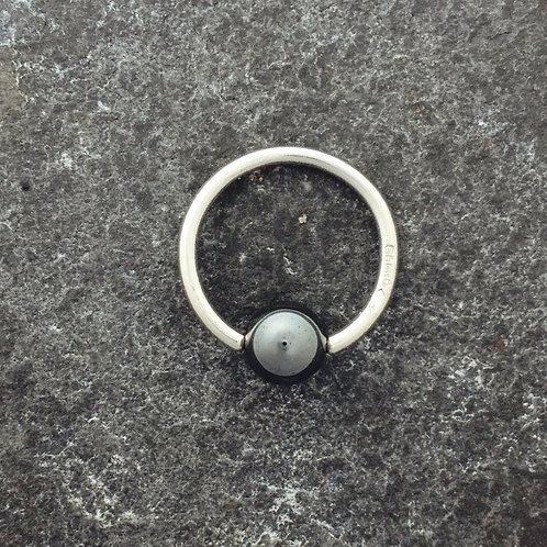 Platinum bead closed ring with a Hematite closure.