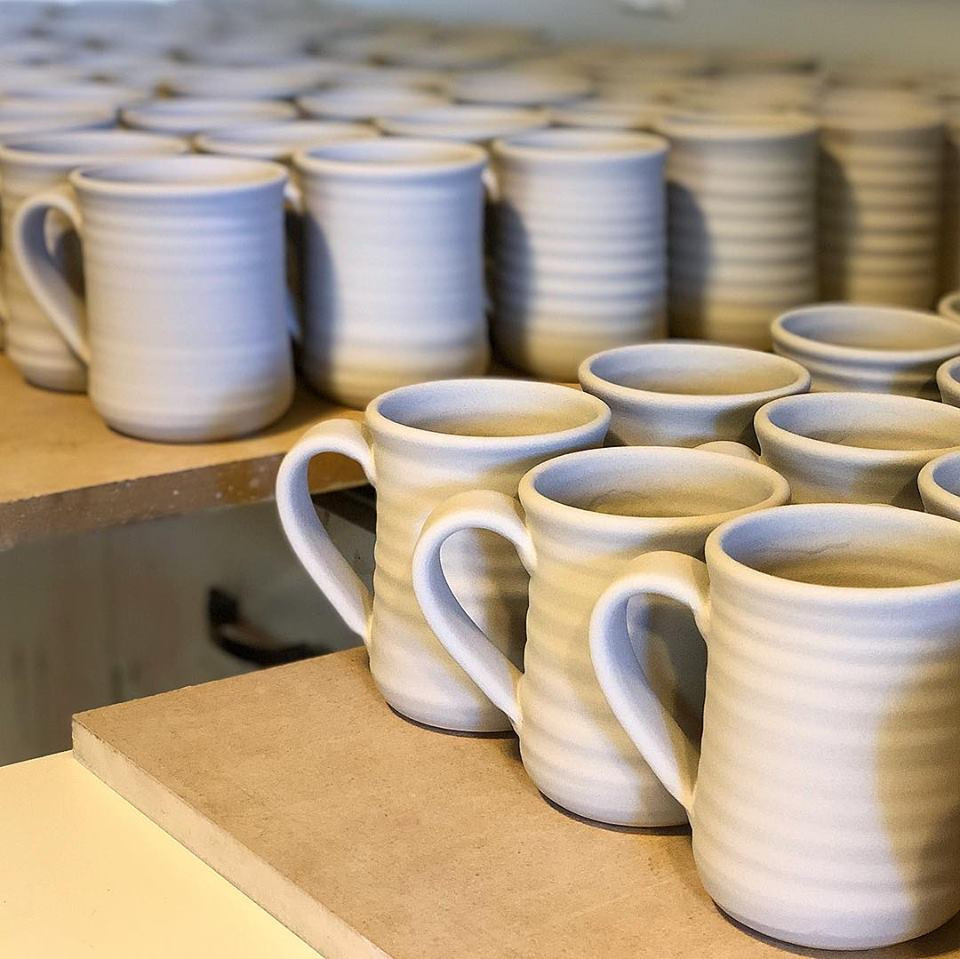 Glazed Mugs ready for the kiln