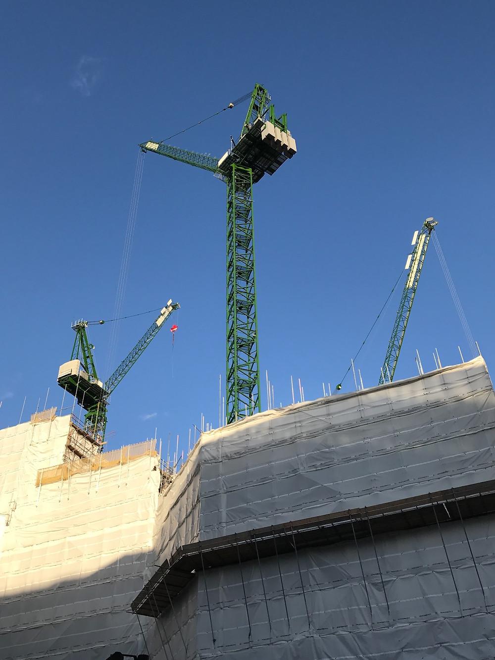Construction Cranes near train station