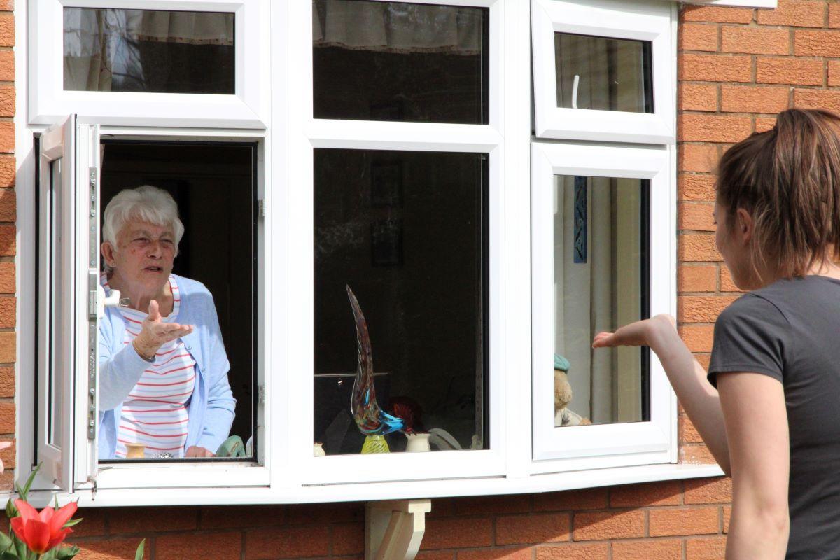 Social distance kiss for grandmother