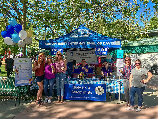 Soroptimists in front of the Soroptimist International of Davis x Sudwerk Beer Booth at the Davis Farmers Market for the club's 65th Anniversary