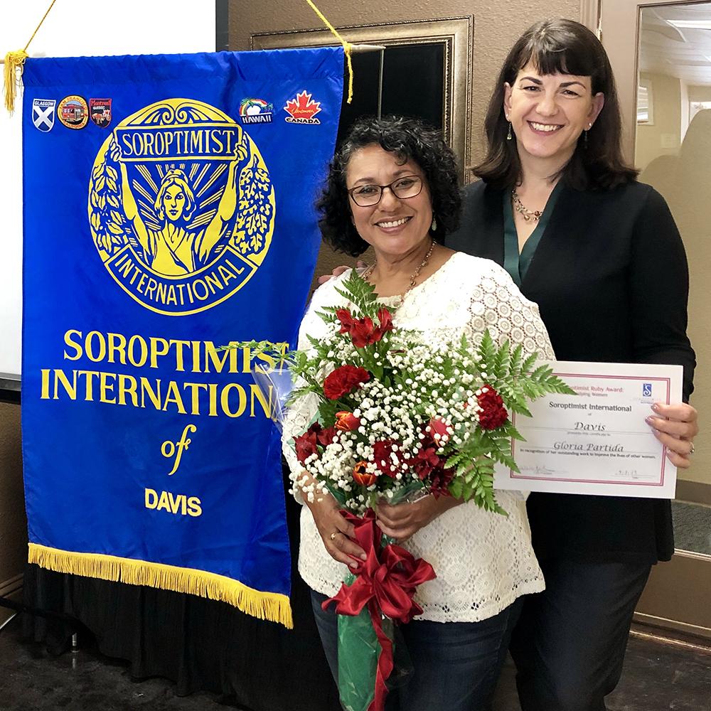 Past SI Davis President Wendy awards community member Gloria Partida the club's Ruby Award