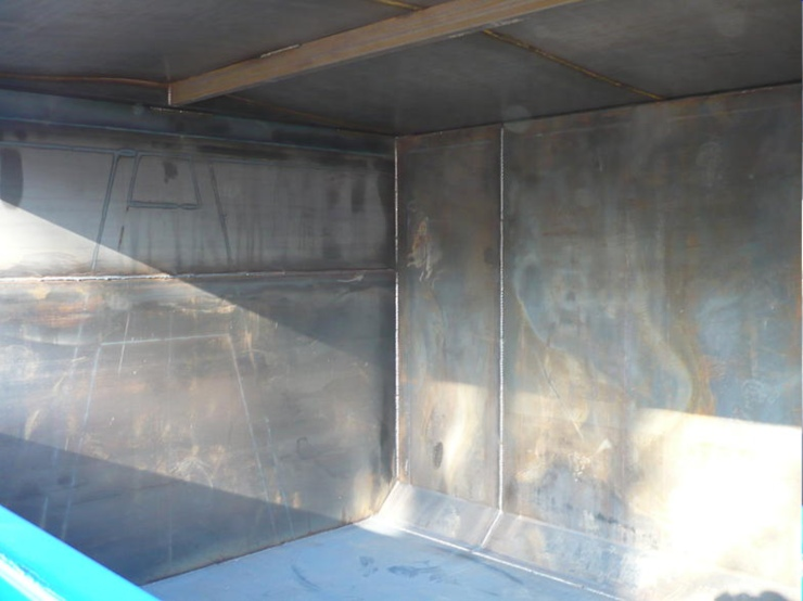 Drop down side loader interior