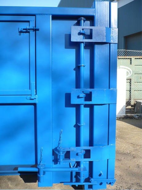 Drop down side loader lock