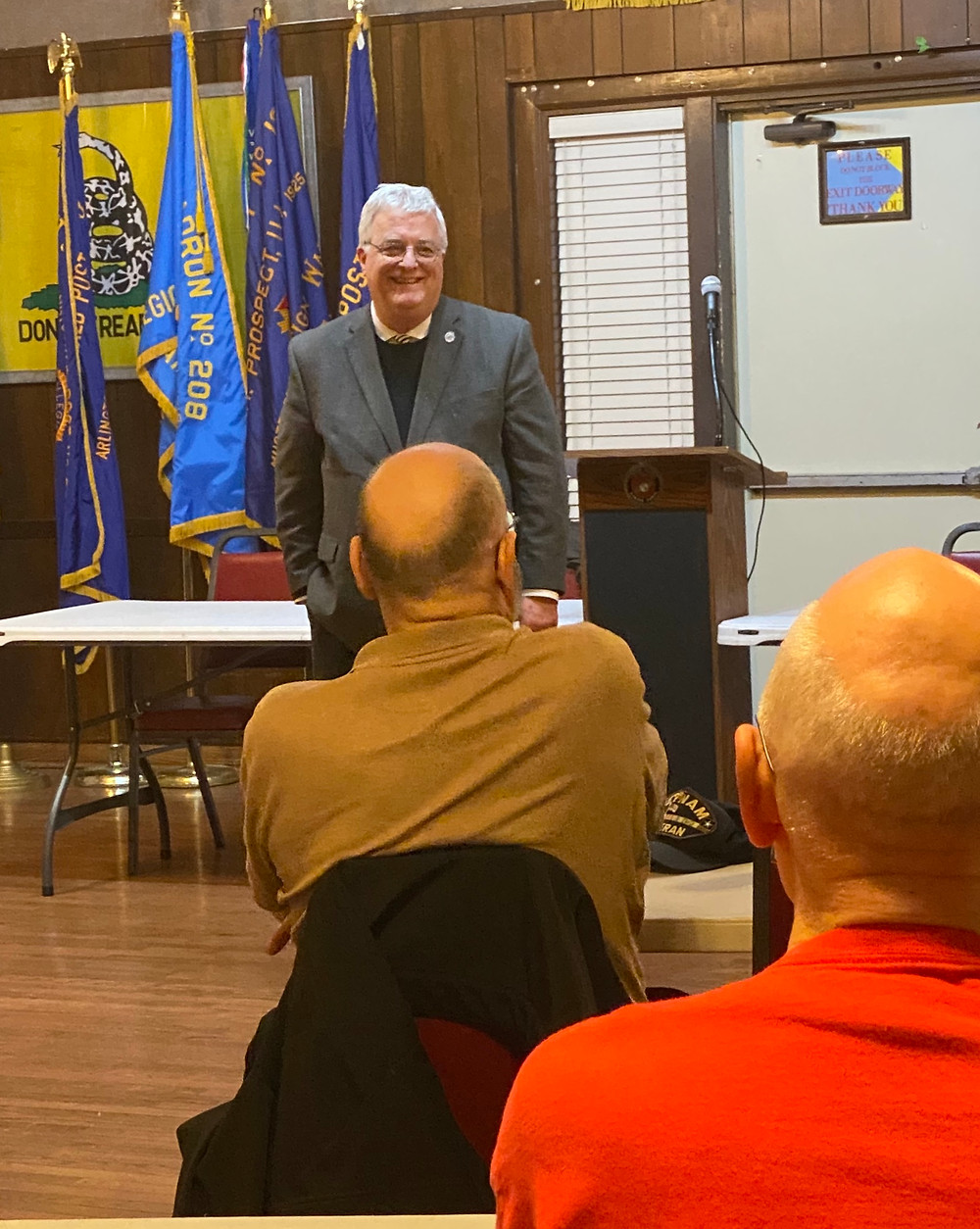 Pictured: Walker (center) speaks with veterans at his recent Veterans' Issues Town Hall.