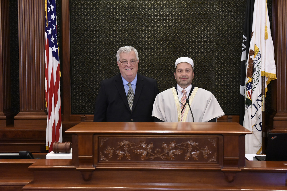Pictured: Walker (left) hosts Imam Nazir Chahin (right) of the Islamic Society of the Northwest Suburbs to perform the House invocation.