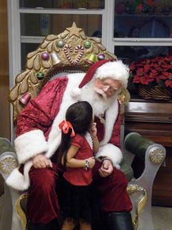 Santa Noel with girl www.allaboutentertainment.com