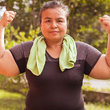 Middle aged obese women exercise in the