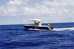 Nosy Be' . open boat.
