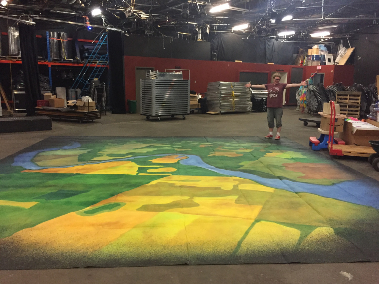 Preparing a new version of the set to tour. New floor cloth painted by Nicole Diebert.