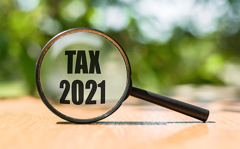 Word Tax 2021 on magnifier glass. Busine