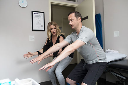 Shannon Littlejohn Burnes teaching a squat
