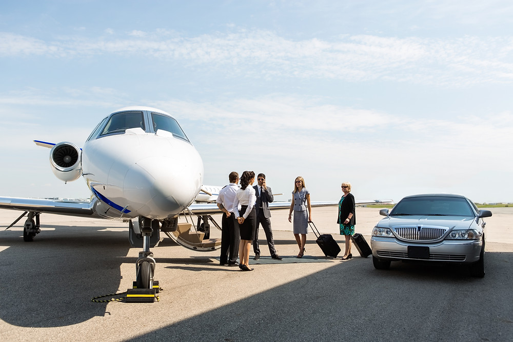 Clients boarding private jet.