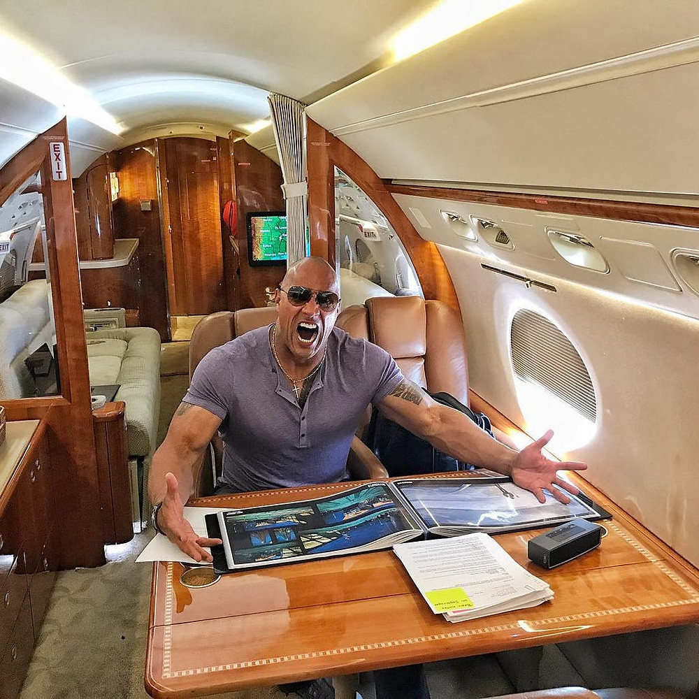 Dwayne Johnson flying in his private jet.